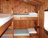Le camere del Rifugio Buzzoni: una da 4 posti letto, una da 6 posti letto e un camerone da 15 posti letto