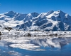 Primo gelo al laghetto di Cedec a inizio autunno, sullo sfondo le cime ghiacciate del pizzo Tresero e della punta San Matteo