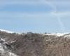 Salendo dal sentiero 11, dalla cresta la vista sul Rifugio